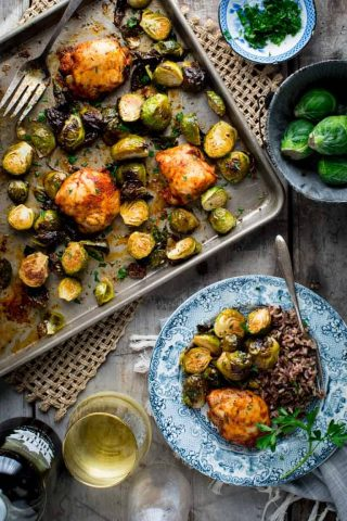 Chicken and Brussels Sprouts Sheet Pan DInner on a sheet pan and also on a plate from overhead
