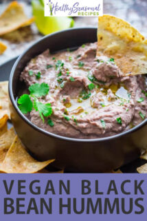 chip dipped in black bean hummus