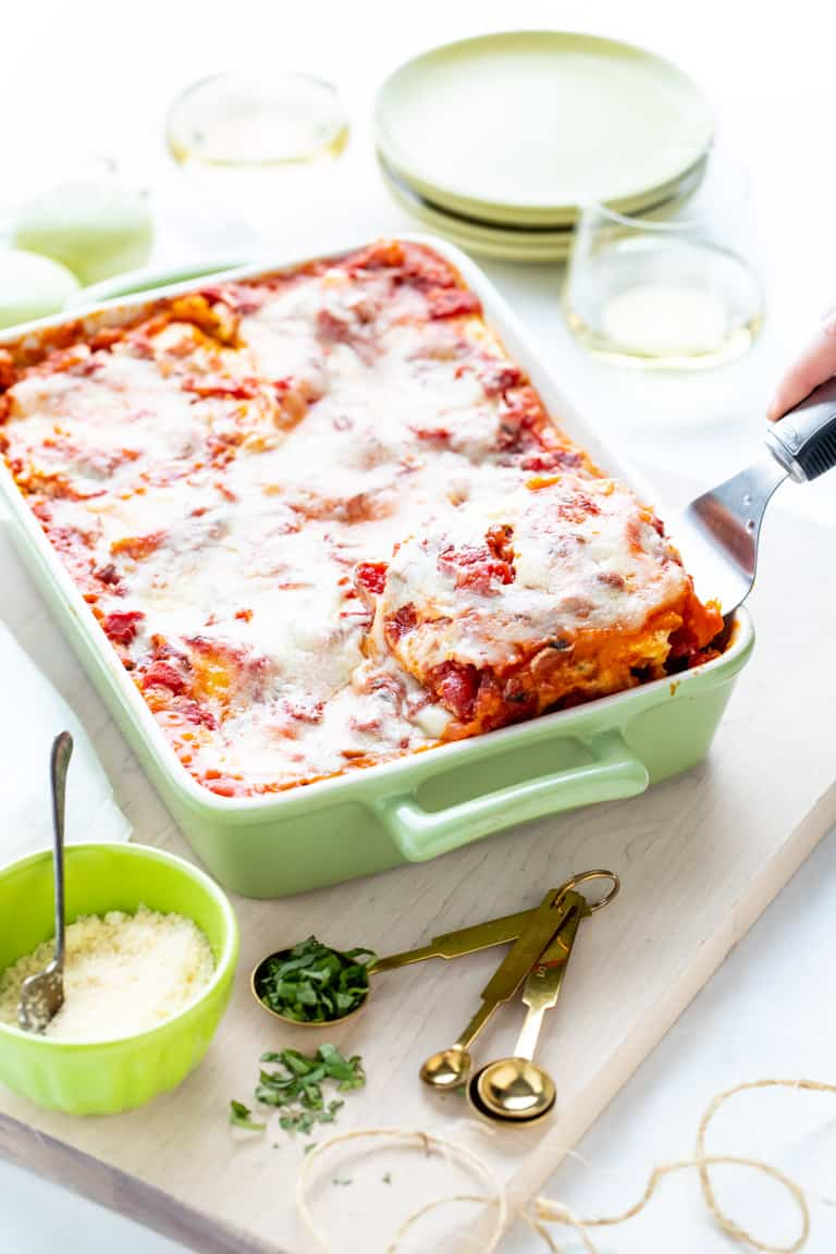 a spatula lifting a slice of butternut squash lasagna