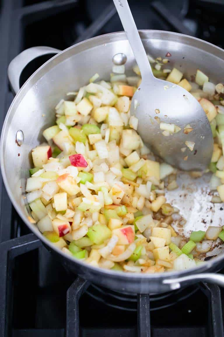 Apples, celery onion and garlic cooking for Mussels recipe.