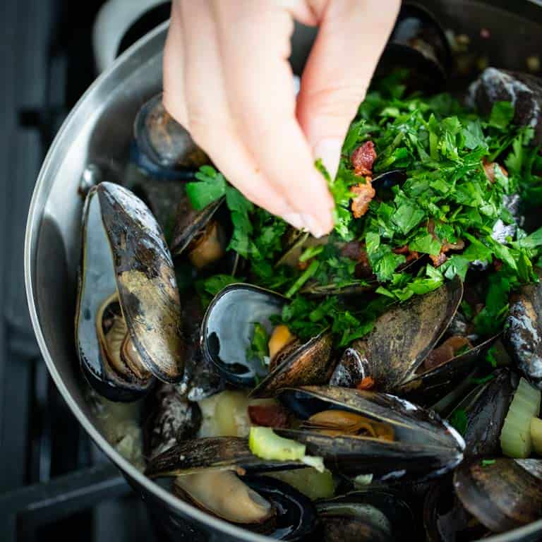 Add parsley and bacon after the mussels have cooked