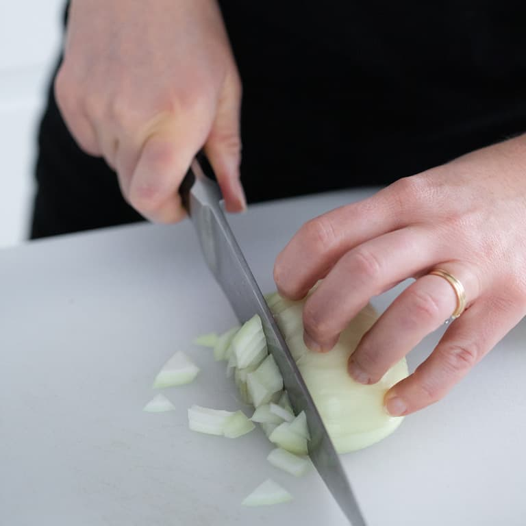 Slice through the onion creating evenly shaped dice pieces