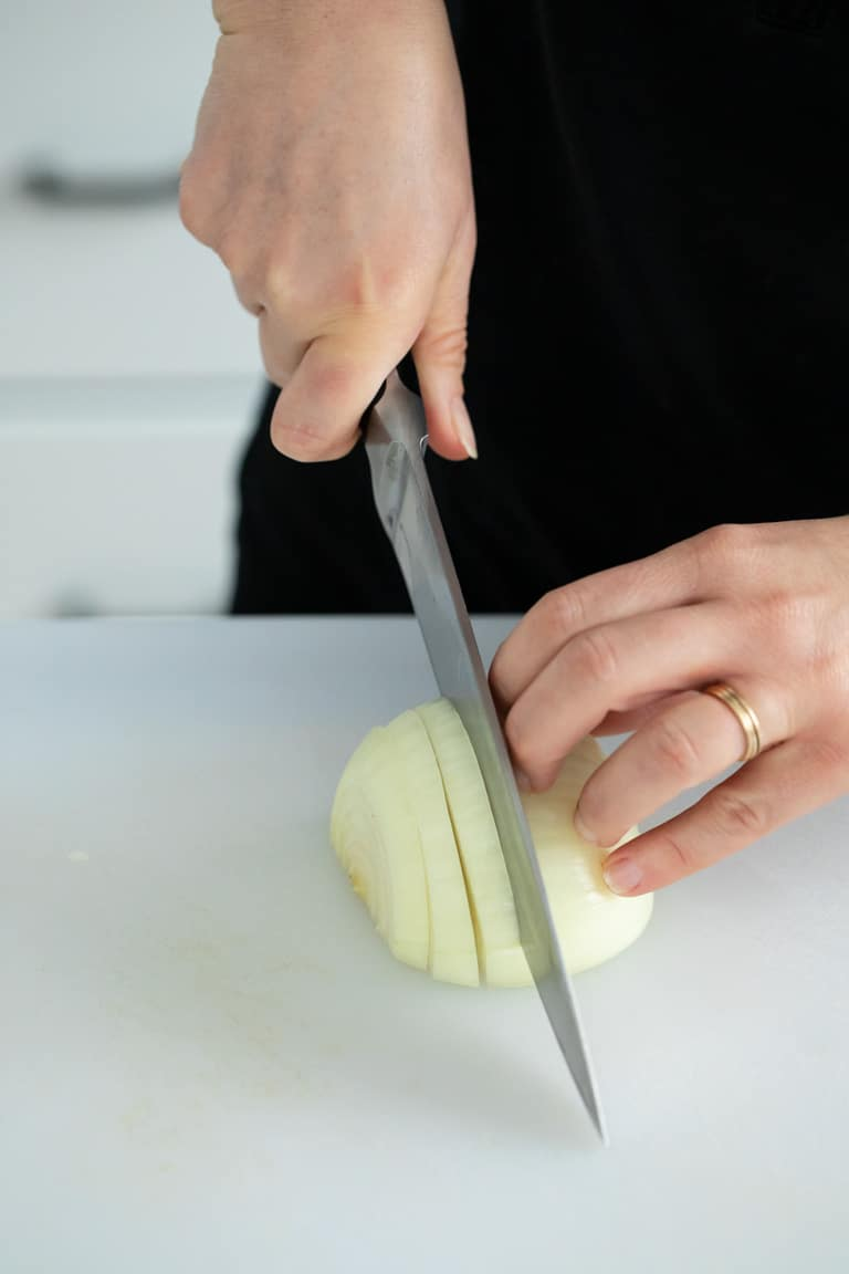 How to Philly Cut an onion, a less refined way to slice an onion for quicker cooking, rustic recipes and when you want the onion to break down as it caramelizes.