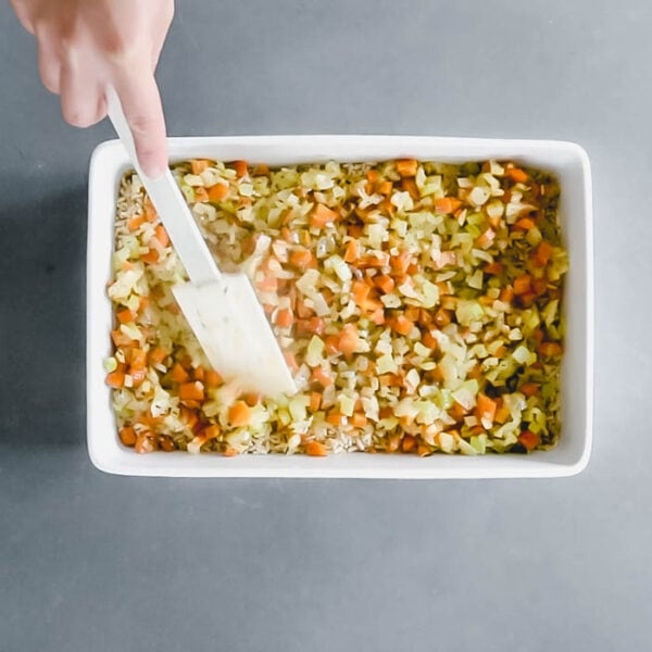 Spread the cooked vegetables over the rice