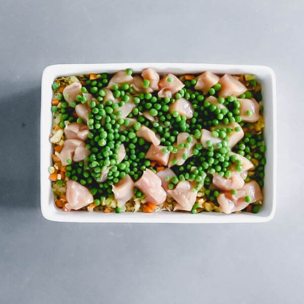 Scatter the peas on top of the casserole