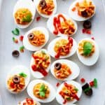 Spicy Deviled Eggs- close up with lots of toppings