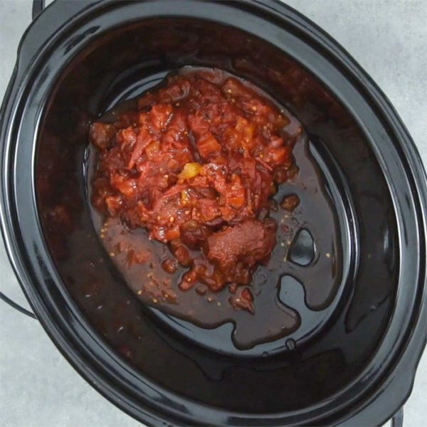 A slow cooker with tomato