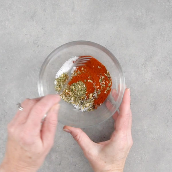 A glass bowl, with spices