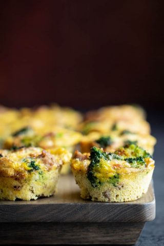 A batch of Paleo Egg Muffins on a gray wooden tray