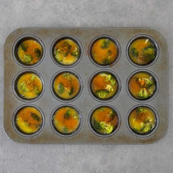 Pour the egg mixture into the muffin tin wells