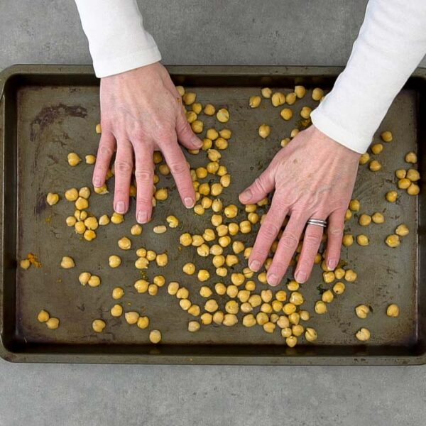 Make sure the chickpeas are coated using your hands