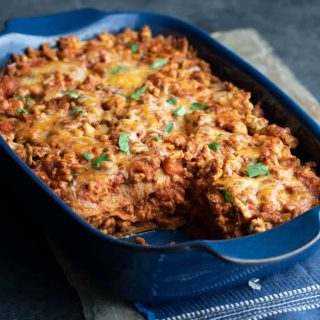 Layered Chicken Enchilada Casserole in a baking dish