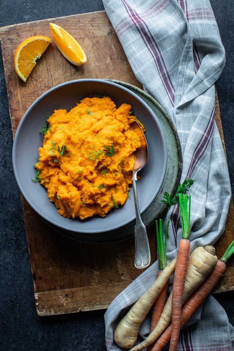 Mashed Carrots and Parsnips in a Gray Bowl.