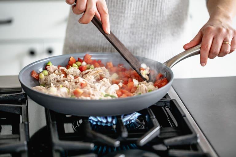 cooking ground chicken in a skillet