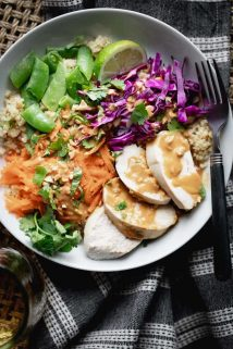 a close up of chicken quinoa bowl with peanut dressing