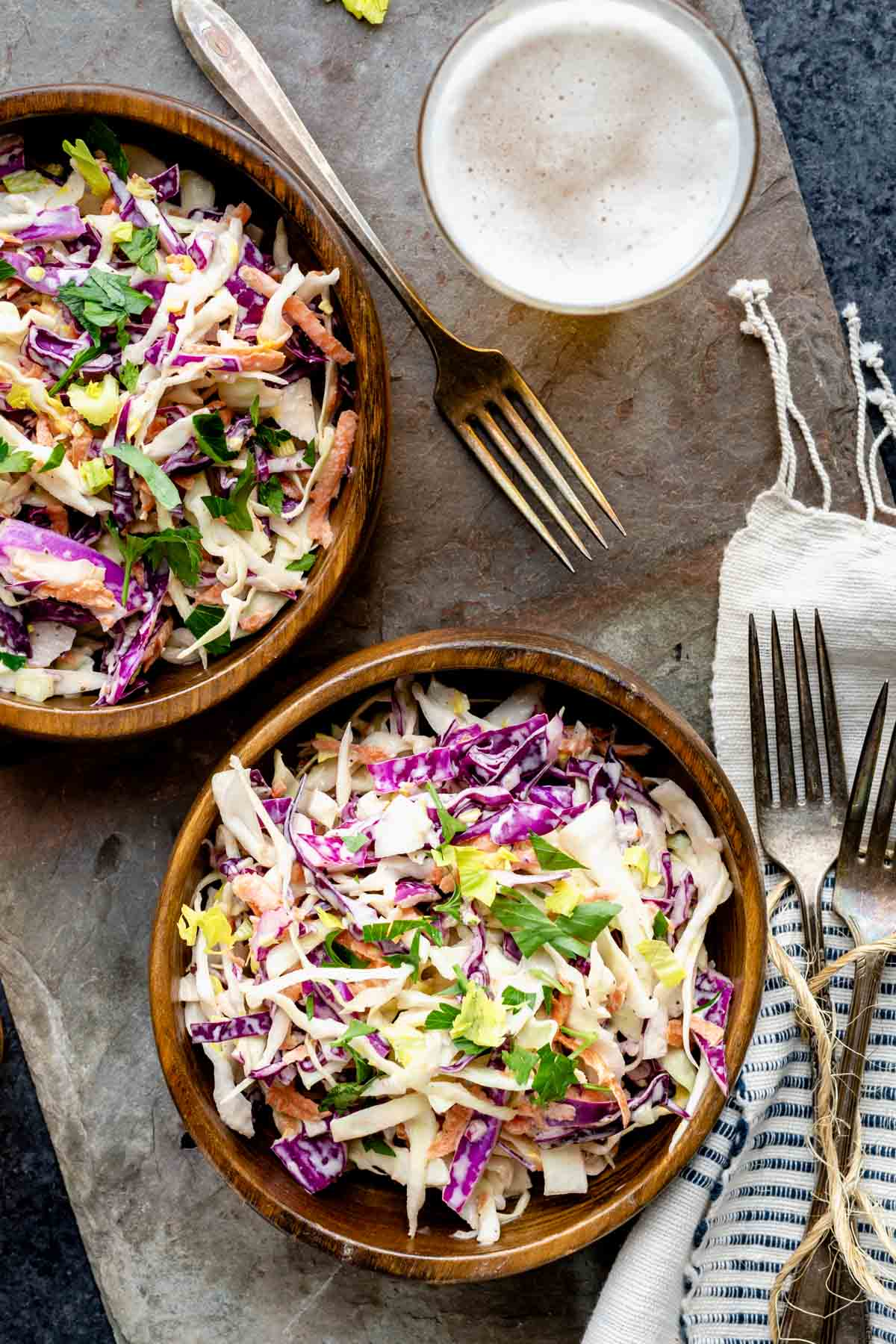 two wooden bowls with slaw in them
