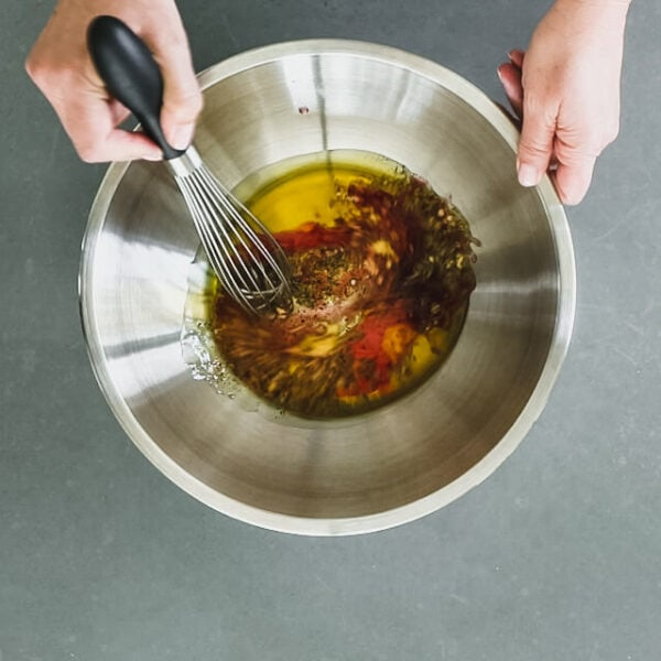 Whisk dressing ingredients in a large bowl