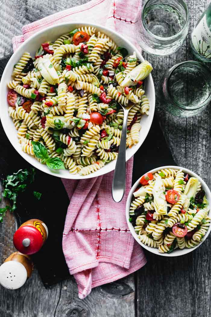 Pasta Salad in a serving bowl, plus another small bowl with a single serving of Italian Pasta Salad
