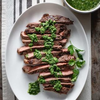 close up of sirloin steak with chimichurri