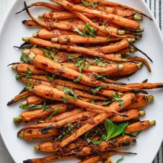 a close-up of grilled carrots