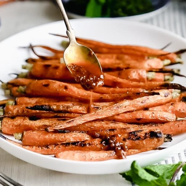 Serve the grilled carrots drizzled with the sauce