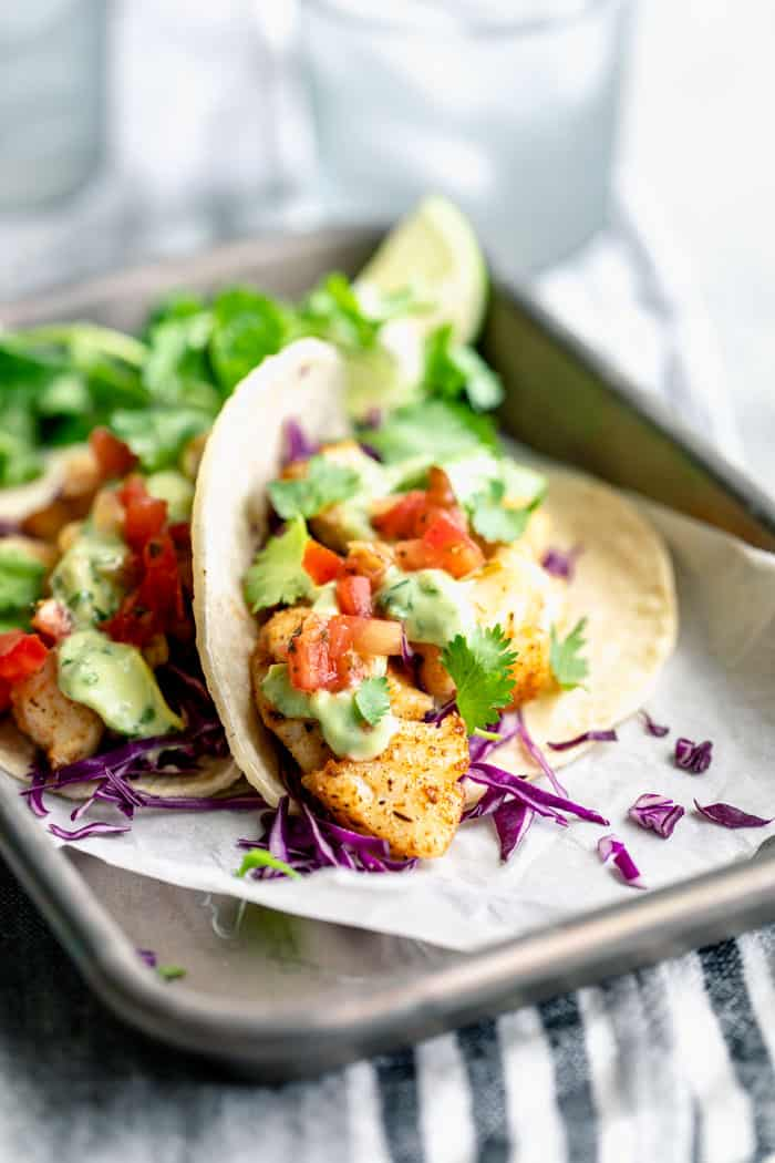 A close up from a side view of cod fish tacos