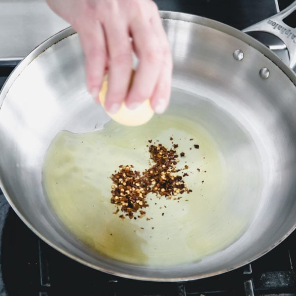 add hot chili flake to the hot oil in the pan