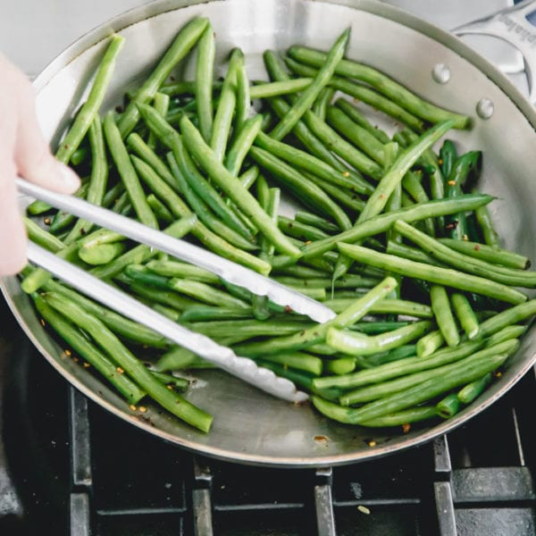 stir green beans until they are blistered and browned in spots