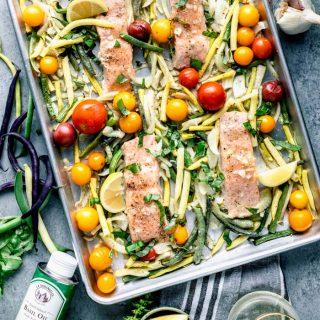 an overhead view of sheet pan salmon with veggies
