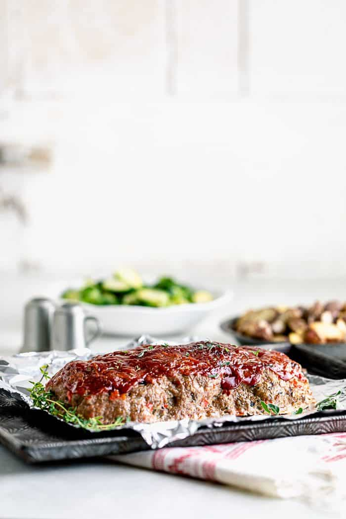Turkey Meatloaf on a sheet pan with ketchup brown sugar glaze
