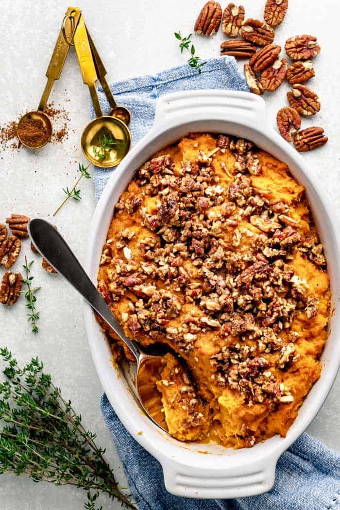 An overhead view of sweet potato casserole with pecans
