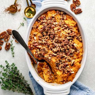 an overhead perspective of sweet potato casserole topped with pecans