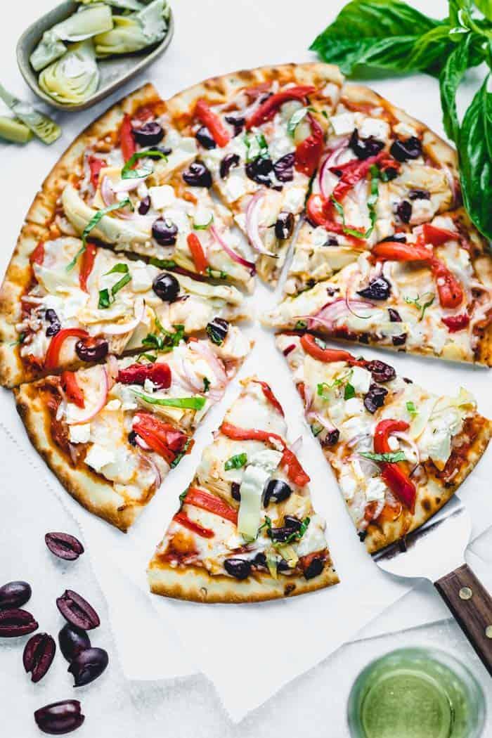 Overhead of sliced greek pizza
