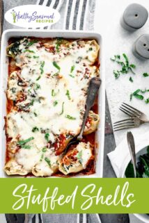 stuffed shells in a casserole dish with one shell in a spoon