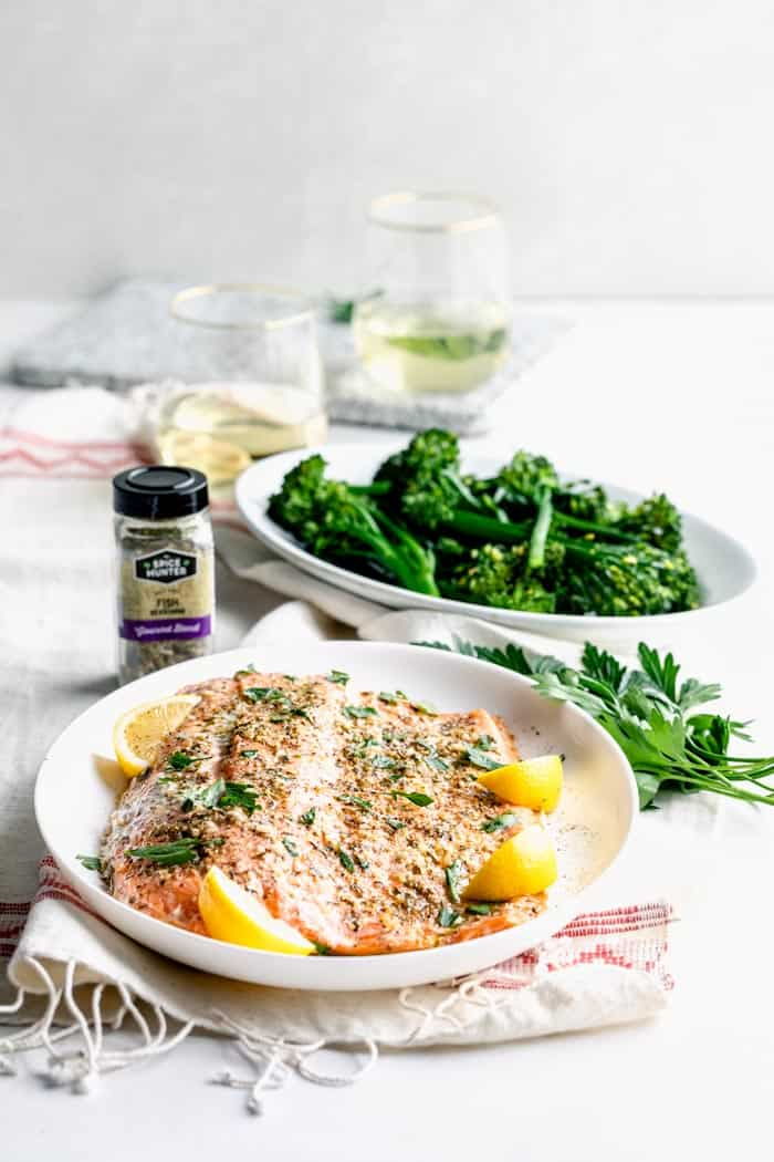 Easy Baked Salmon on a table with broccolini