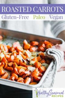 holding sheet pan of carrots