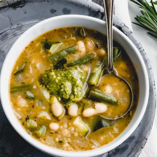 a close up of a bowl of soupe au pistou from overhead