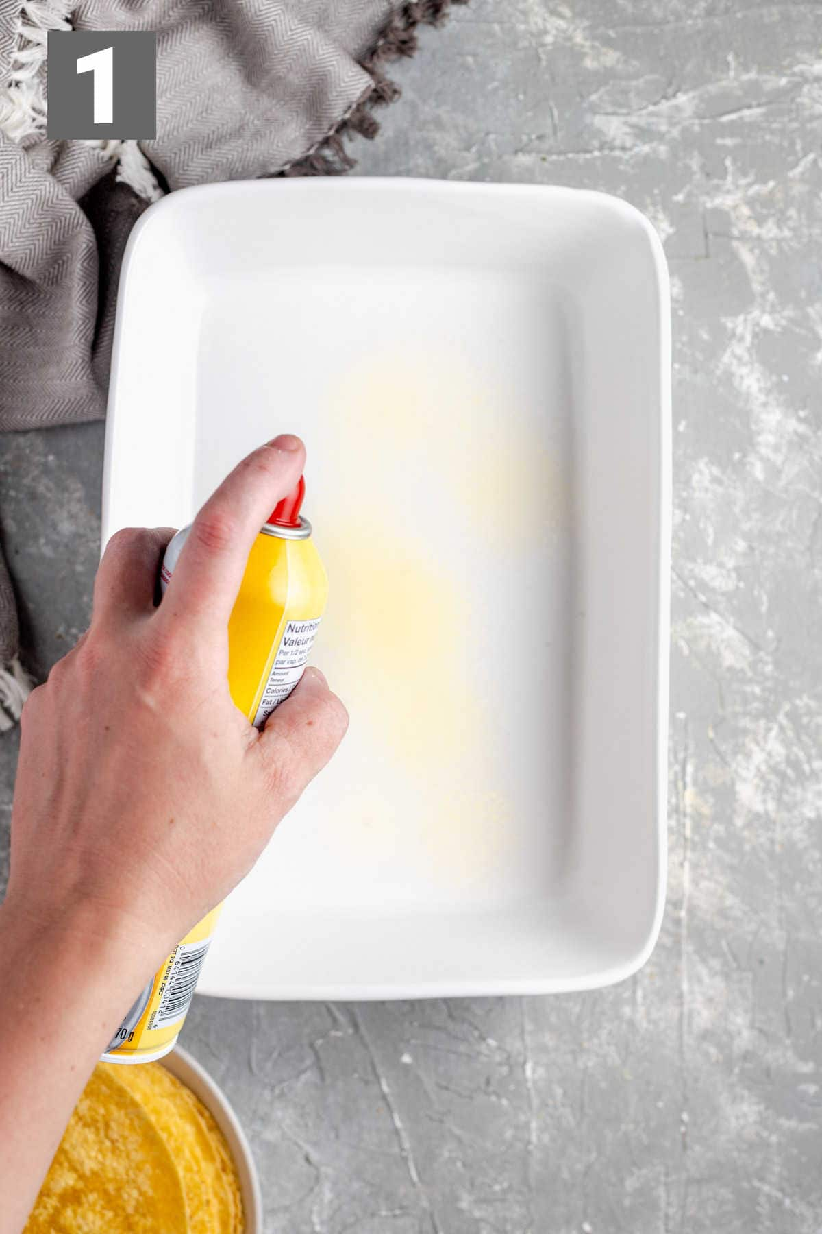 spraying the casserole dish