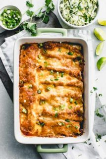 Overhead view of a casserole dish with baked chicken enchiladas