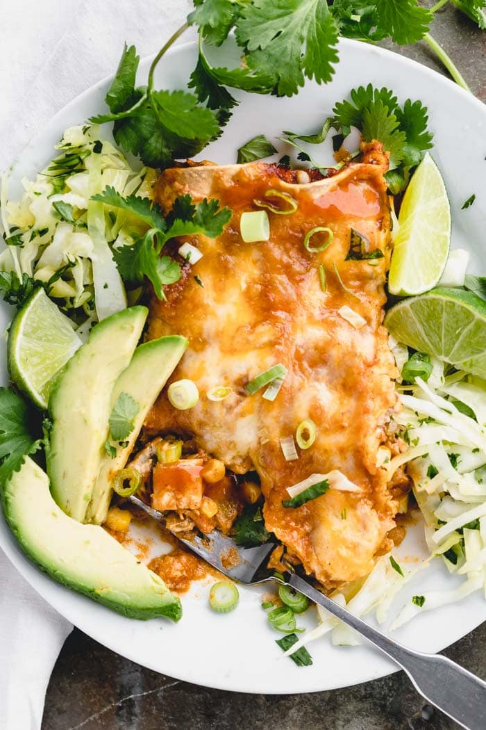 Make authentic tasting chicken enchiladas at home with this easy recipe! #chickenenchiladas #redenchiladas #healthyseasonal