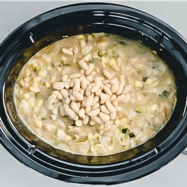 white chili with white beans on top