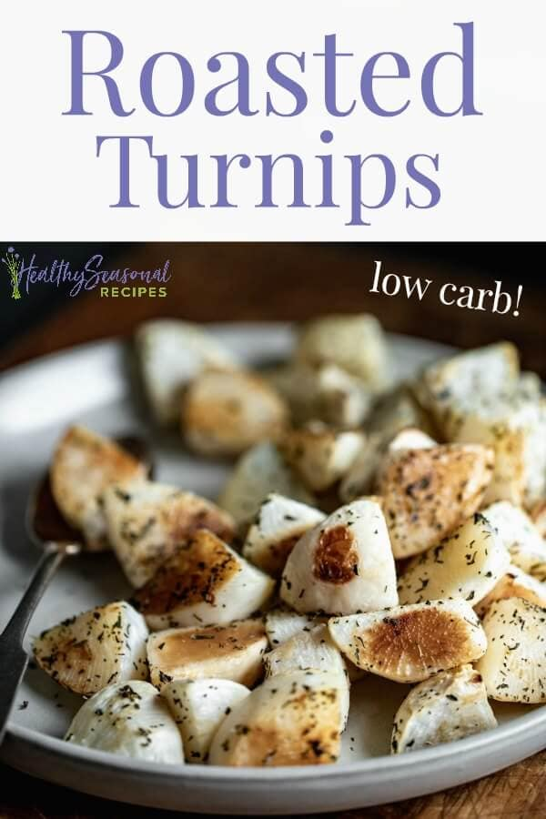 Roasted turnips on a white plate from the side