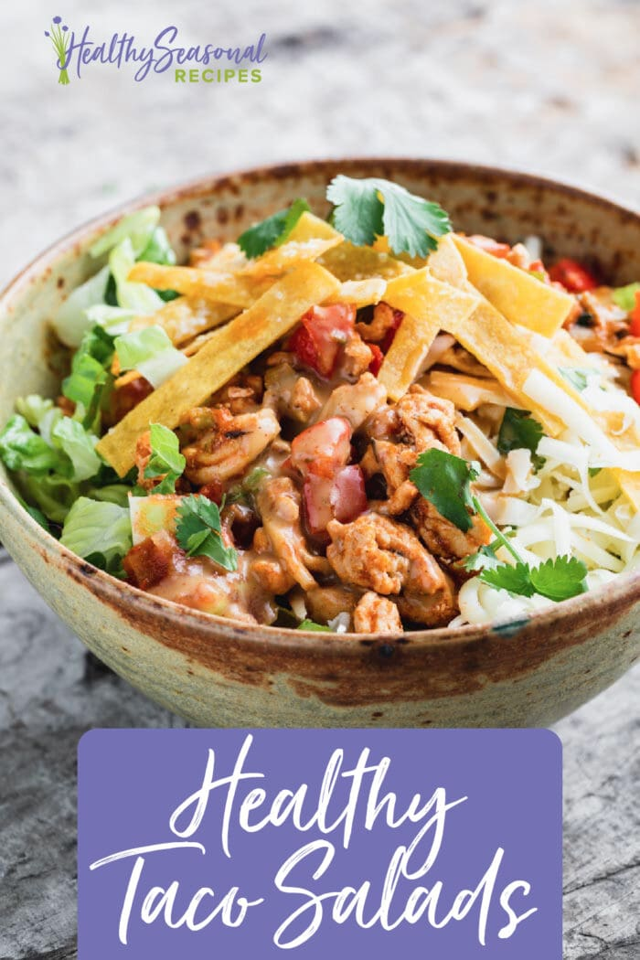 Taco salad from the side with light background and text overlay
