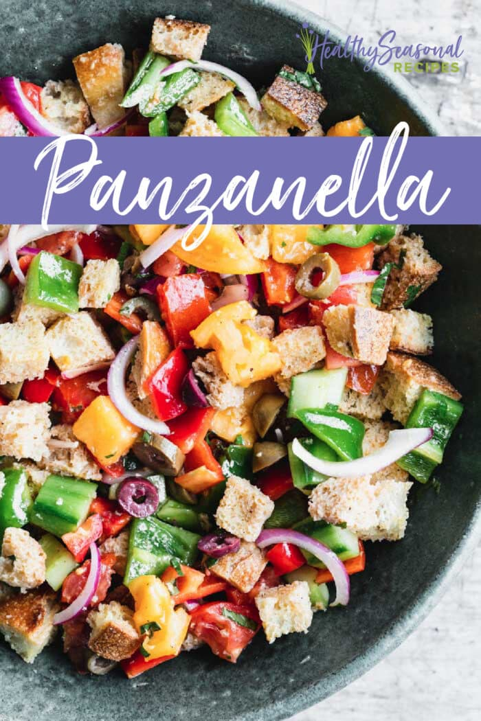 panzanella salad in a large bowl overhead withtext overlay