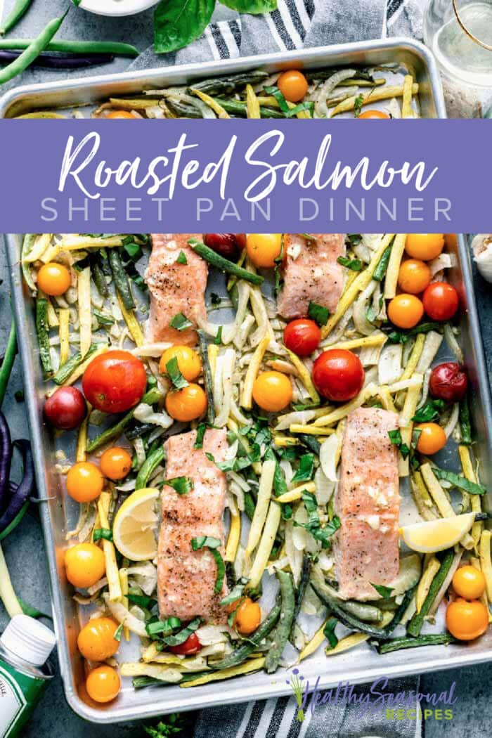 sheet pan with salmon and veggies overhead with text overlay