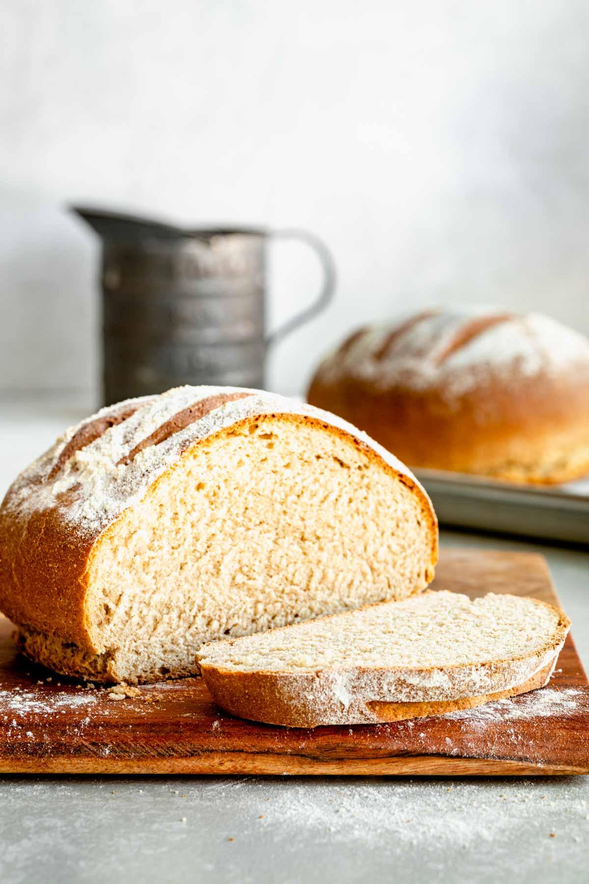 a loaf of bread cut open on a board