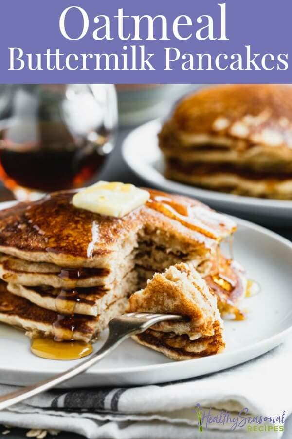 a large stack of pancakes with syrup and butter