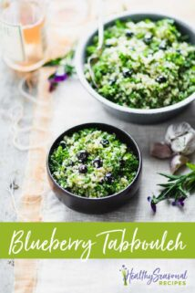 blueberry quinoa tabbouleh on a white and peach cloth with violets