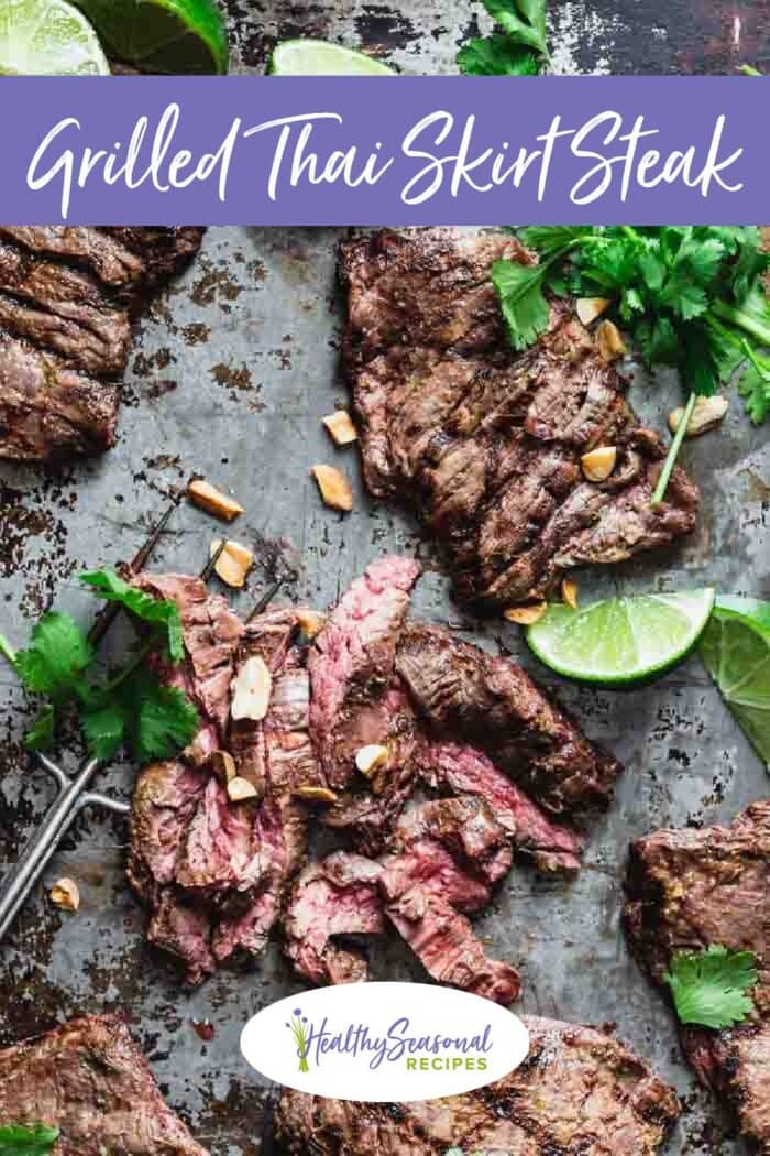 Grilled steak on a baking sheet with cilantro and peanuts on top