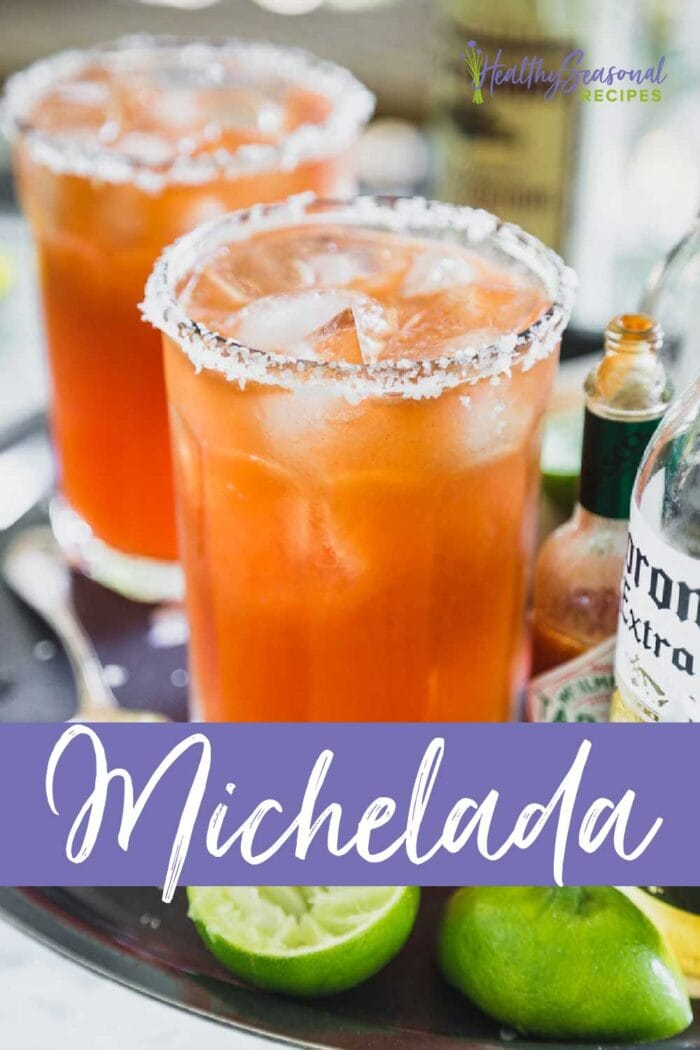 michelada in two glasses with a salted rim